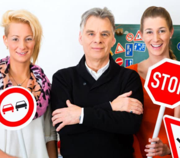 group of people holding road signs