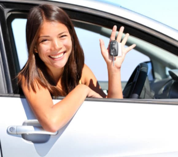 female in the car holding car key